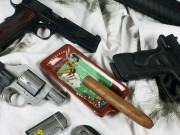 Gun and Cigars – Lets Strike a Match Up